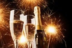 Champagne con le stelle filante Fotografia Stock