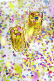 Champagne and confetti. Two glasses of  wine and falling confetti Royalty Free Stock Photos
