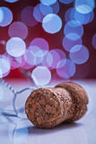 Champagne corck on white table and blurred background with bokeh Stock Photo