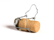 Champagne cork. Wooden stopper it is isolated on a white background Royalty Free Stock Photography