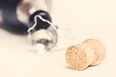 Champagne cork. Against bottle. Toned image Royalty Free Stock Photo