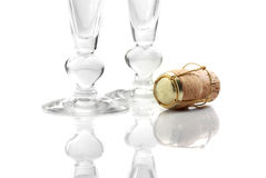 Champagne cork. Silver champagne cork and glasses isolated over a white background Royalty Free Stock Image