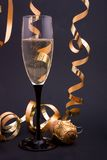 Champagne and cork. A glass of champagne, streamers and a cork Stock Photos