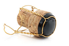 Champagne Cork. With gold wire and black metal top, isolated on white with soft shadow Stock Photo
