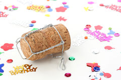 Champagne cork and confetti Royalty Free Stock Photo