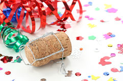 Champagne cork and confetti Royalty Free Stock Image