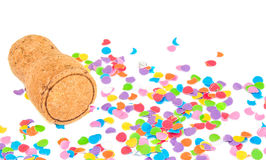 Champagne cork on confetti background. Royalty Free Stock Photo