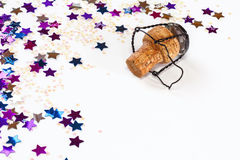 Champagne Cork and Confetti. Champagne cork with confetti or glitter on white background with copy space Royalty Free Stock Images