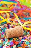 Champagne cork on confetti Stock Photo