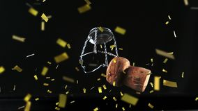 Champagne cork with falling confetti. Animation of a close up of champagne cork falling down and with golden confetti falling on a black background stock illustration