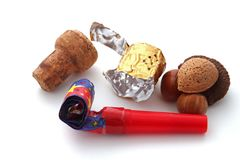 Champagne cork, foil, blower and nuts Royalty Free Stock Images