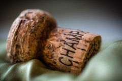 Champagne cork on green fabric. Close-up of champagne cork Royalty Free Stock Photography