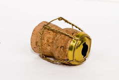 Champagne cork (left view). Champagne cork on white background royalty free stock photo