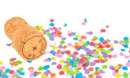 Champagne-cork op confettienachtergrond Stock Fotografie