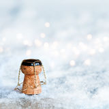 Champagne cork in the snow. Champagne cork with bokeh in the snow for congratulations Stock Images