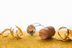 Champagne cork with 2018 stamp and serpentine Stock Photo