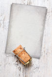 Champagne cork whit card Royalty Free Stock Photo