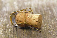 Champagne cork. On wooden table after party Royalty Free Stock Photography