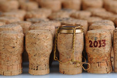 Champagne Corks With 2013 Date. Closeup of a large group of Champagne corks, that fill the frame. Selective focus on the front row. One cork has the date 2013 Royalty Free Stock Images