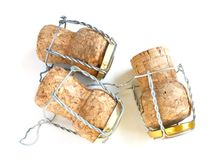 Champagne corks. Three champagne corks over a white background royalty free stock photos