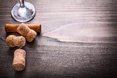 Champagne corks with corkscrew on vintage wooden Stock Photos