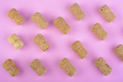 Champagne corks on pink Royalty Free Stock Photos