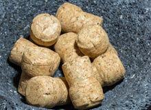 Champagne corks in stone bowl Stock Image