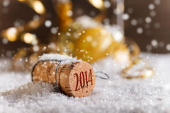 Champagne corks. With 2014 year stamp in snow Stock Photos