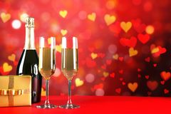 Champagne for couple in love in two flutes on table with red tablecloth royalty free stock photos