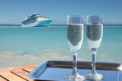 Champagne and cruise ship. Silver tray with glasses of champagne. Cruise ship in background. Travel and celebration concept royalty free stock photos