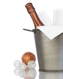 Champagne, Crystal Flutes Chilling in Bucket. Elegant Champagne and Crystal Glass Flutes Chilling in Texured Hammered Metal Wine Bucket With Bronze & Silver Stock Photography