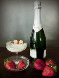 Champagne, a cup of fresh cream and strawberries. Strawberries and fresh cream to exalt the champagne taste and celebrate an anniversary stock photo