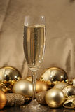 Champagne cup3. Champagne cup over a golden background royalty free stock image
