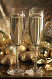 Champagne cups2. Champagne cups over a golden background royalty free stock image