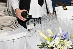 Champagne dans le calice Photos libres de droits
