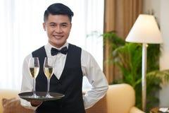 Champagne de portion photographie stock