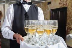 Champagne del servizio Fotografia Stock