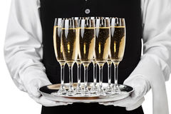 Champagne del servizio del cameriere su un vassoio fotografia stock libera da diritti