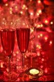 Champagne in den Gläsern und in der Kerzeleuchte Lizenzfreies Stockfoto