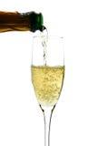Champagne derramou dentro ao vidro Fotos de Stock