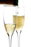 Champagne derramou dentro ao vidro Foto de Stock Royalty Free