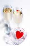 Champagne e cuore di plastica Fotografia Stock Libera da Diritti