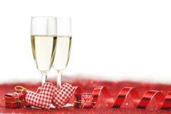Champagne e decorazione rossa Fotografia Stock