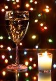 Champagne e festão Fotografia de Stock Royalty Free