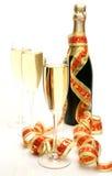 Champagne e fita Fotografia de Stock