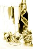 Champagne e fita Imagens de Stock
