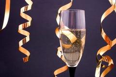 Champagne e flâmulas Foto de Stock