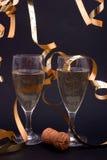 Champagne e flâmulas do ouro Fotos de Stock