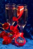 Champagne e flores Imagens de Stock