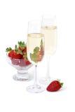 Champagne e morangos Foto de Stock